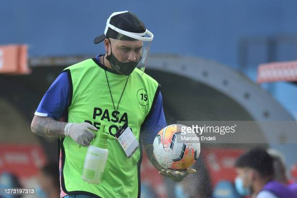 Ball boy disinfects a match ball during a group F match of Copa CONMEBOL Libertadores 2020 between Racing and Nacional at Juan Domingo Peron Stadium...
