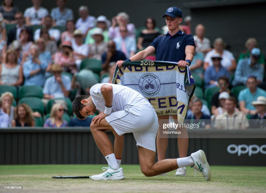 A Ball Boy Hands A Towel To Novak Djokovic Of Serbia Falls Over News Photo Getty Images
