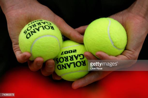 A ball boy holds three tennis balls on day nine of the French Open at Roland Garros on June 4 2007 in Paris France