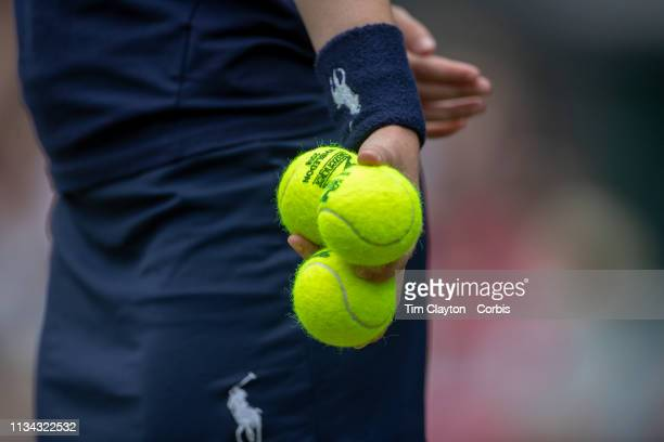 A ball boy in action on Centre Court during the Wimbledon Lawn Tennis Championships at the All England Lawn Tennis and Croquet Club at Wimbledon on...