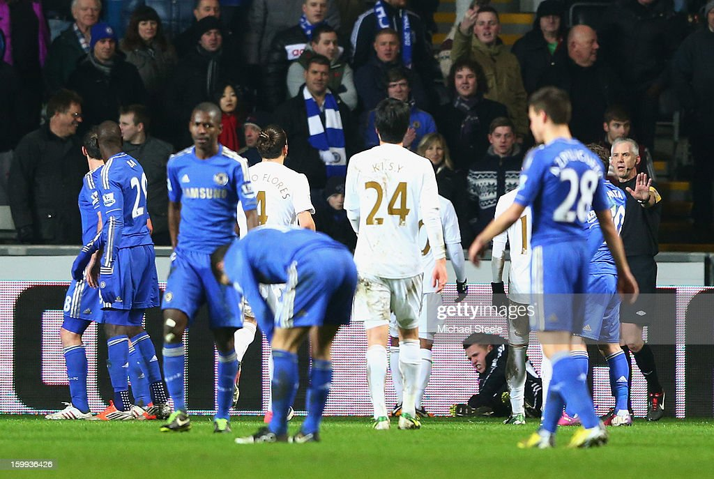 A ball boy lays on the ground after being kicked by Eden Hazard of Chelsea who is then sent off during the Capital One Cup Semi-Final Second Leg match between Swansea City and Chelsea at Liberty Stadium on January 23, 2013 in Swansea, Wales.