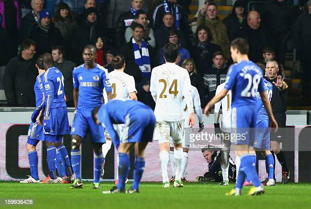 A ball boy lays on the ground after being kicked by Eden Hazard of Chelsea who is then sent off during the Capital One Cup SemiFinal Second Leg match...
