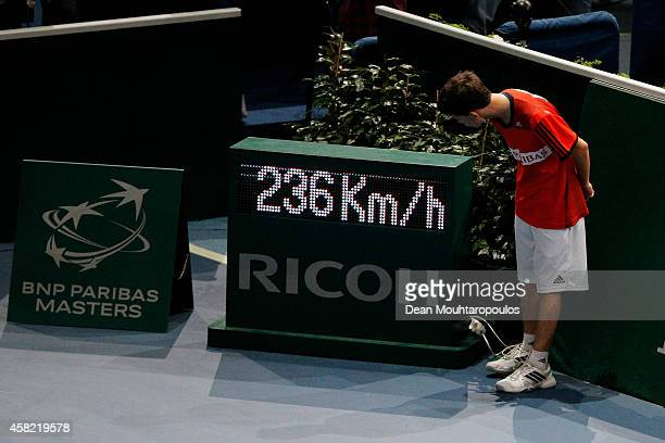 A ball boy looks at the radar display and the 236km serve speed by Milos Raonic of Canada against Tomas Berdych of Czech Republic in their semi final...