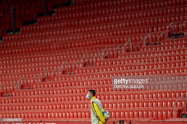 Ball boy observes the Spanish League football match between Sevilla and Real Valladolid at the Ramon Sanchez Pizjuan stadium in Seville on June 26,...