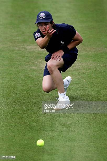 A ball boy pass a ball during day three of the Wimbledon Lawn Tennis Championships at the All England Lawn Tennis and Croquet Club on June 28 2006 in...