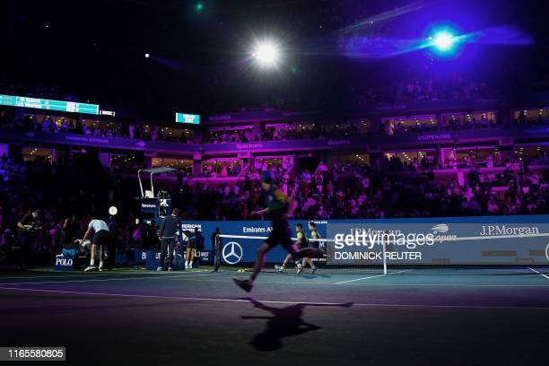 Ball boy runs across the court before Novak Djokovic of Serbia faces Stan Wawrinka of Switzerland in their Round Four Men's Singles tennis match...