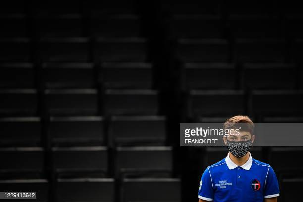 Ball boy stands in front empty seats during the men's singles first round tennis match between Hungary's Marton Fucsovics and Croatia's Borna Coric...