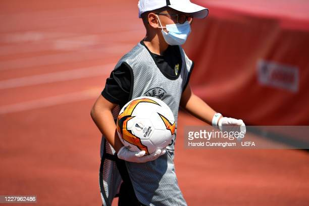 Ball boy wearing protective equipment on during the UEFA Champions League 2020/21 Preliminary Round Semi-final match between S.S. Tre Fiori F.C. And...