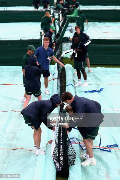 Ball boys and girls cover the courts due to wet weather condistions during the 2017 Wimbledon qualifying session on June 27 2017 in London England
