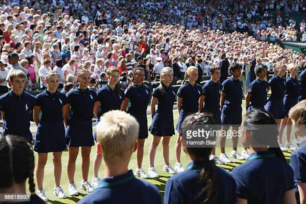 Ball boys and girls form a guard of honour after the women's singles final match between Venus Williams of USA and Serena Williams of USA on Day...