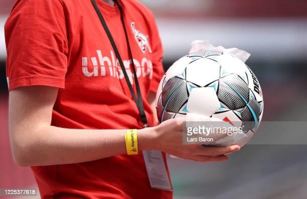 Ball boys disinfect the footballs ahead of the Bundesliga match between 1. FC Koeln and 1. FSV Mainz 05 at RheinEnergieStadion on May 17, 2020 in...