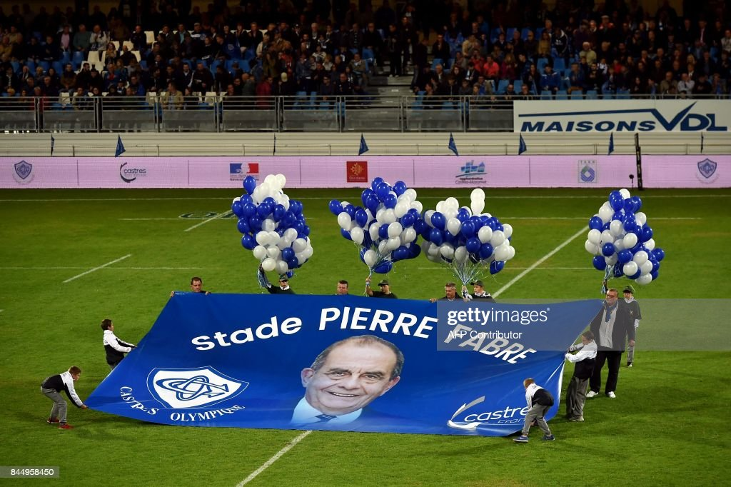 Ball boys hold a banner for the stadium's new name ahead of the French L1 football match between Troyes (ESTAC) and Toulouse (TFC) on September 9, 2017, at the Aube Stadium in Troyes, eastern France. /
