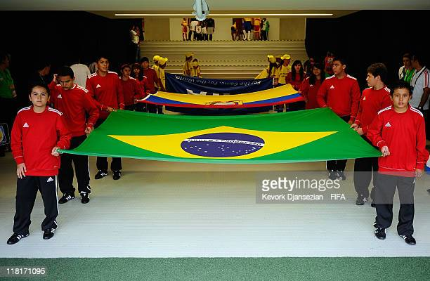 Ball boys hold the Brazil and Ecuador flags during the FIFA U17 World Cup Round 16 match between Ecuador and Brazil at Estadio Guadalajara on June 29...