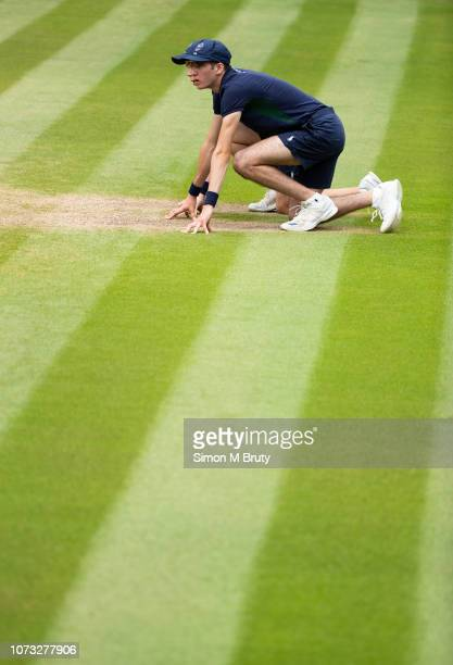 Ball boys on center court during The Wimbledon Lawn Tennis Championship at the All England Lawn Tennis and Croquet Club at Wimbledon on July 14, 2018...