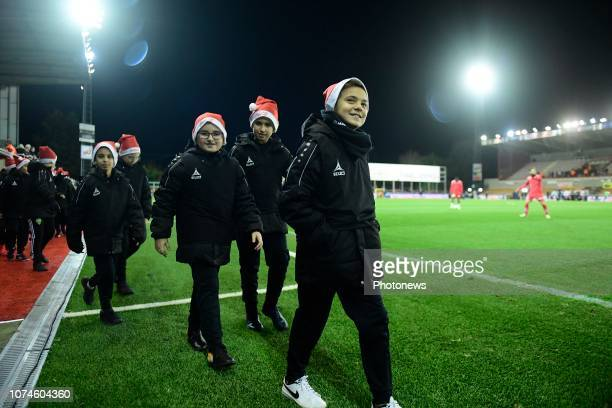 Ball boys with a Santa Claus hat on before the Jupiler Pro League match between Royal Excel Mouscron and RSC Anderlecht at the Le Canonnier stadium...