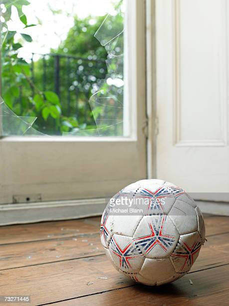 ball by smashed window - broken stock photos and pictures