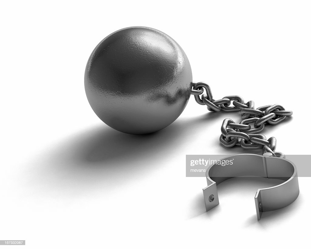 A ball connected to an unlocked cuff by a chain : Stock Photo