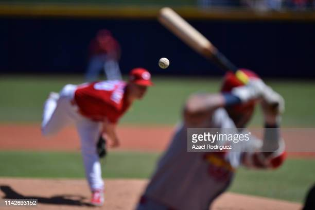 Ball flies while Anthony DeSclafani of the Cincinnati Reds pitches in the first inning of the second game of the Mexico Series between the Cincinnati...