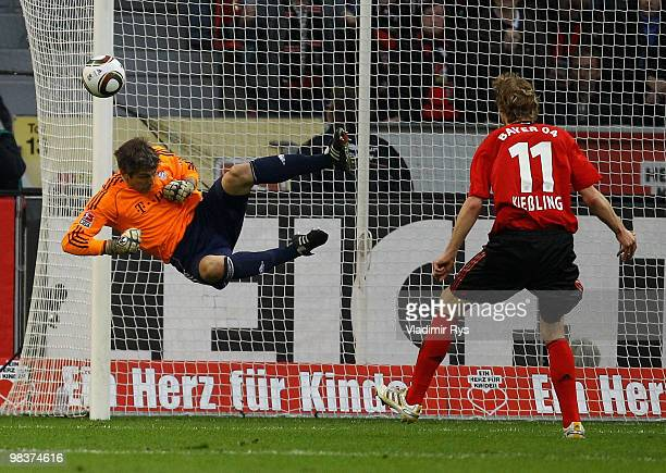 A ball from a free kick hits the pole as Joerg Butt of Bayern jumps on during the Bundesliga match between Bayer Leverkusen and FC Bayern Muenchen at...