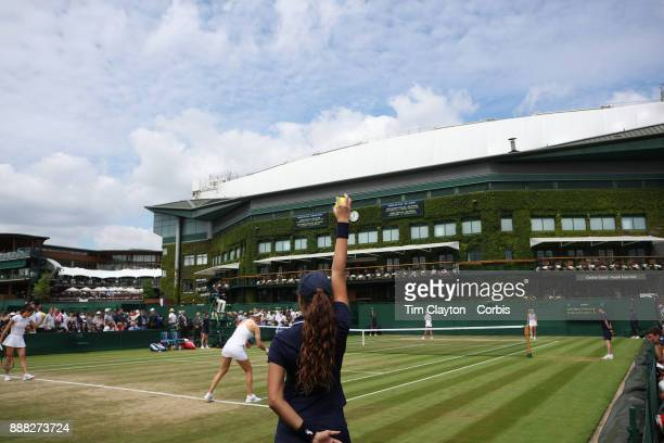 A ball girl holds a ball during Andrea Petkovic of Germany and Mirjana LucicBaroni of Croatia playing their Ladies' Doubles match against Lucie...