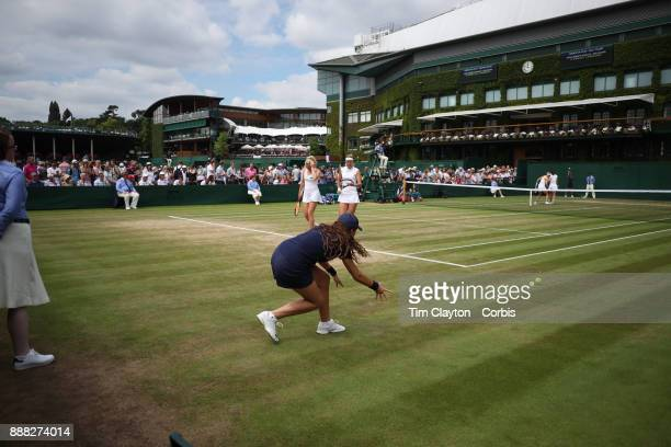 A ball girl in action as Lucie Hradecka of the Czech Republic and Katerina Siniakova play their Ladies' Doubles match against Andrea Petkovic of...