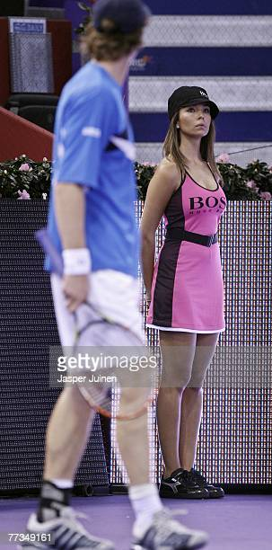 A ball girl looks on flanked by Andy Murray during the ATP Masters Series tennis tournament match between Andy Murray and Radek Stepanek on October...