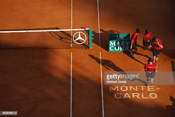 Ball girls and boys run during the quarter final match between Novak Djokovic of Serbia and Sam Querrey of USA on day seven of the Masters Series at...