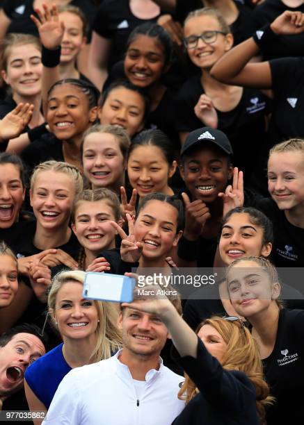 Ball Girls pose for a selfie with David Goffin of Belgium during qualifying Day 2 of the FeverTree Championships at Queens Club on June 17 2018 in...