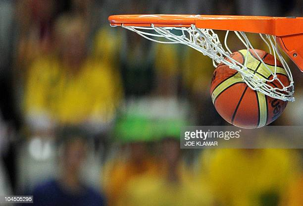 A ball goes into a basket as Australia scores 3 points during the Women's FIBA World Championship 2010 match Australia vs Belarus in Ostrava on...