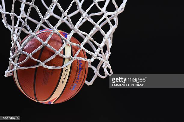 A ball goes through the basket prior to the classification basketball match between Greece and Latvia at the EuroBasket 2015 in Lille northern France...