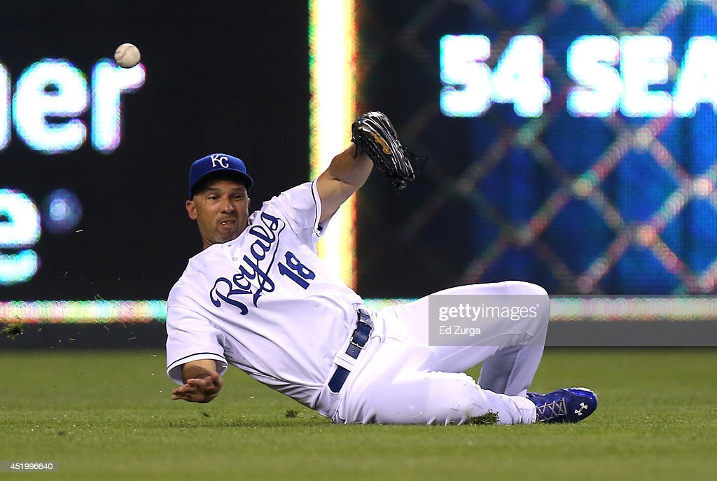 A ball hit by J.D. Martinez of the Detroit Tigers gets past Raul Ibanez #18 of the Kansas City Royals in the fifth inning at Kauffman Stadium on July 10, 2014 at Kauffman Stadium in Kansas City, Missouri.