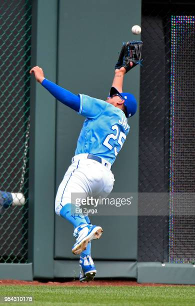 Ball hit by Jeimer Candelario of the Detroit Tigers bounces off the glove of Jon Jay of the Kansas City Royals in the third inning at Kauffman...