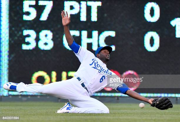 A ball hit by Kevin Kiermaier of the Tampa Bay Rays gets past Lorenzo Cain of the Kansas City Royals in the first inning at Kauffman Stadium on...