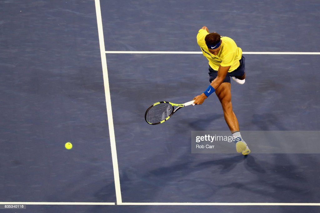 A ball hit by Nick Kyrgios of Australia goes past Rafael Nadal of Spain during Day 7 of the Western and Southern Open at the Linder Family Tennis Center on August 18, 2017 in Mason, Ohio.