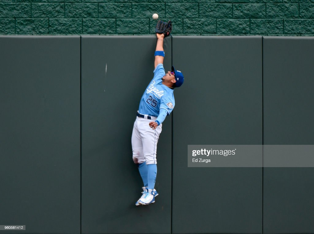 A ball hit by Tyler Austin #26 of the New York Yankees goes over the wall and past the glove of Jon Jay #25 of the Kansas City Royals in the fifth inning at Kauffman Stadium on May 20, 2018 in Kansas City, Missouri.