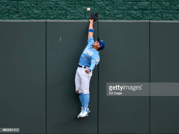A ball hit by Tyler Austin of the New York Yankees goes over the wall and past the glove of Jon Jay of the Kansas City Royals in the fifth inning at...