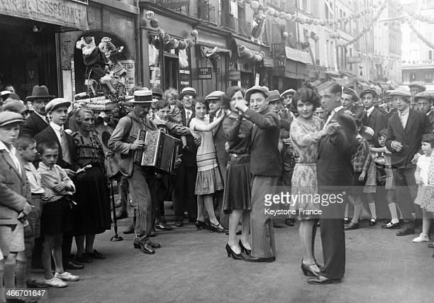 Ball in a street on July 14, 1929 in Paris, France.