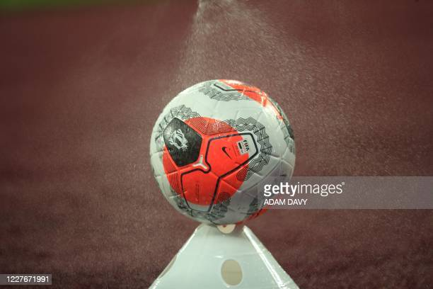 Ball in disinfected during a drinks break in the English Premier League football match between West Ham United and Watford at The London Stadium, in...