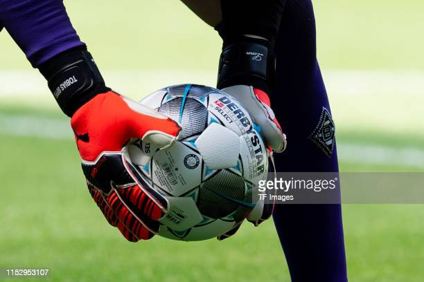 Ball in Hand, The official BUndesliga ball Derbystar Brilliant Bundesliga 19/20 APS is seen during a training session at Borussia-Park on June 30,...