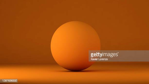 3d ball in orange background - ball stock pictures, royalty-free photos & images