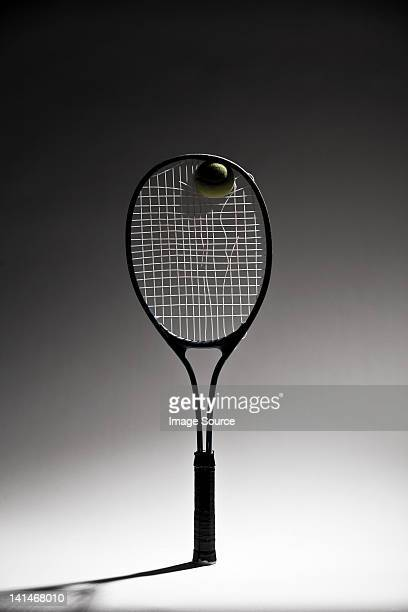 Ball in tennis racket