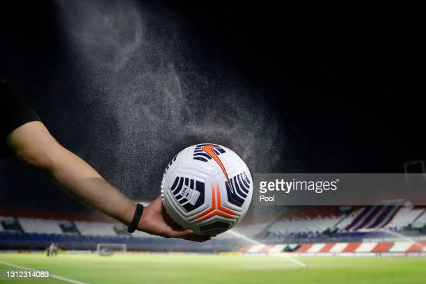 Ball is disinfected before a third round first leg match between Independiente del Valle and Gremio as part of Copa CONMBEOL Libertadores at...