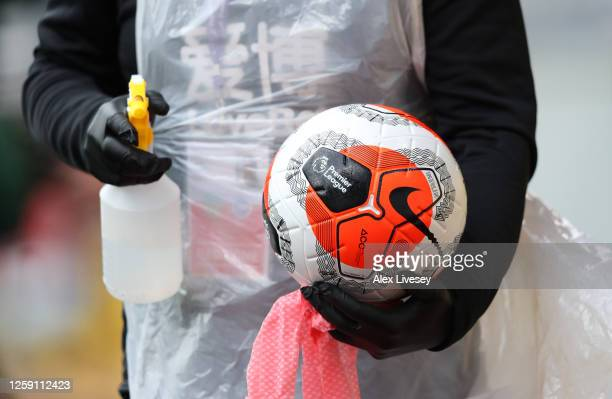 Ball is disinfected by ground staff during the Premier League match between Burnley FC and Brighton & Hove Albion at Turf Moor on July 26, 2020 in...