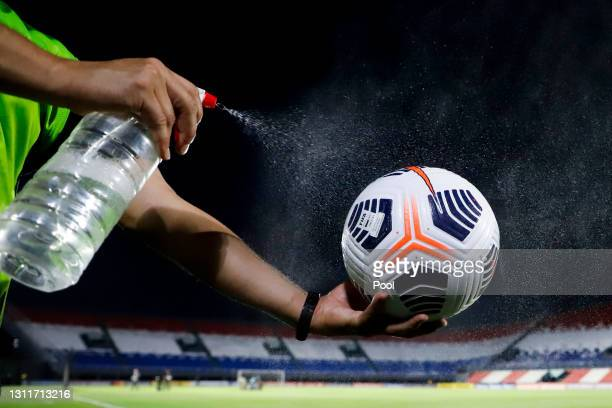 Ball is disinfected prior a third round first leg match between Independiente del Valle and Gremio as part of Copa CONMBEOL Libertadores at...