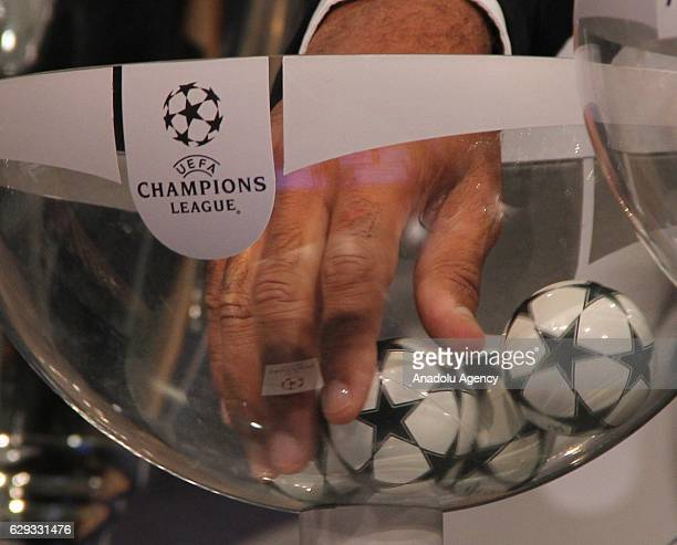 A ball is picked up during the draw for the round of 16 of the UEFA Champions League at the UEFA headquarters in Nyon on December 12 2016