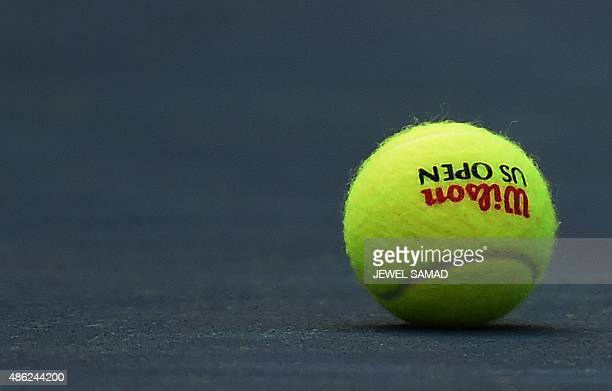 A ball is pictured on the court before a 2015 US Open women's singles round 2 match between Serena Williams of the US and Kiki Bertens of the...