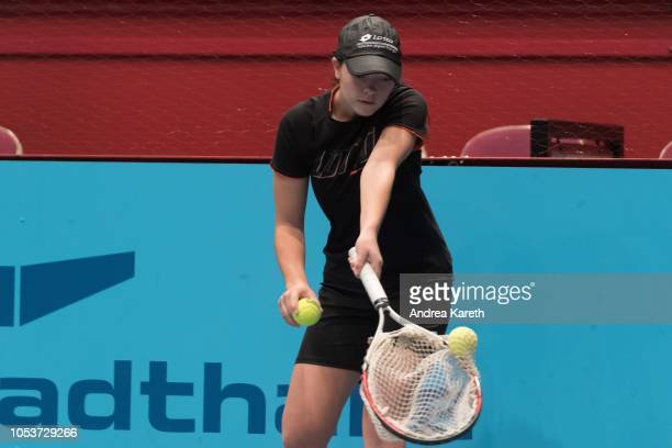 A ball kid catches a ball during warmup before the round of 8 match between Mikhail Kukushkin of Kazakhstan and Marton Fucsovics of Hungary on day...