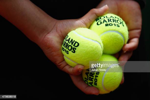 A ball kid holds official tennis balls Court Philippe Chatrier on day of the 2015 French Open at Roland Garros on June 2 2015 in Paris France