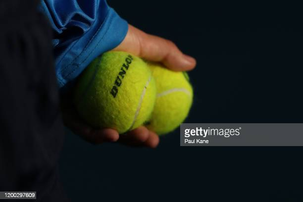 A ball kid holds tennis balls during the men's singles grand final between Lloyd Harris of South Africa and Andrey Rublev of Russia on day seven of...