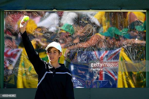Ball kid offers a tennis ball to a player in the doubles match between Lleyton Hewitt and Chris Guccione of Australia and Denis Istomin and Farrukh...